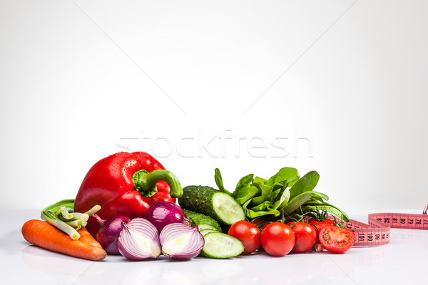 The tape measure with tomatoes and vegetables on white Stock photo © master1305