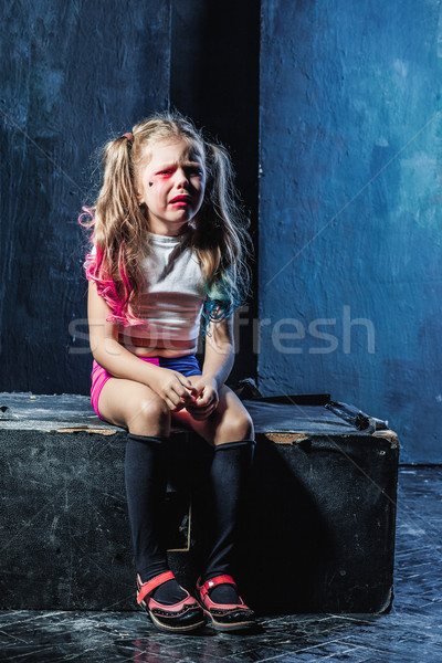 The crying crasy girl on dark background Stock photo © master1305