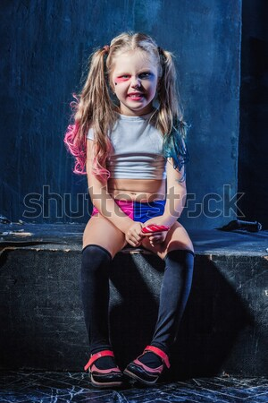 Halloween theme: Girl with baseball bat ready to hit Stock photo © master1305