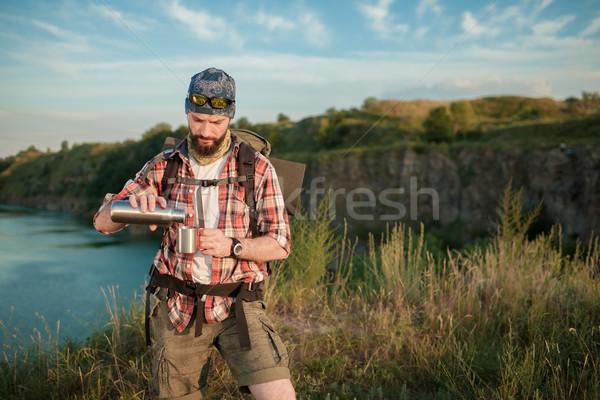 молодые кавказский человека рюкзак питьевая вода Сток-фото © master1305