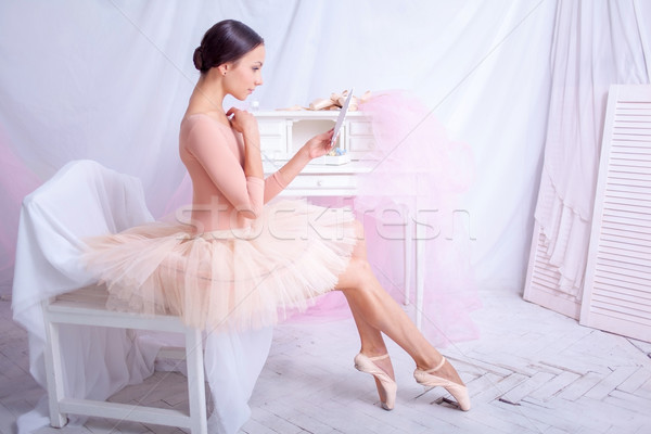 Professional ballet dancer looking in the mirror on pink Stock photo © master1305
