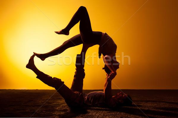 Stock fotó: Két · személy · gyakorol · jóga · naplemente · fény · kettő