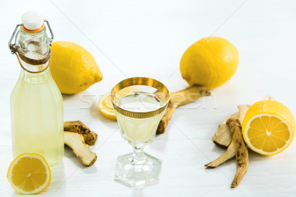 Otthon gyömbér üveg friss citromok fehér Stock fotó © master1305