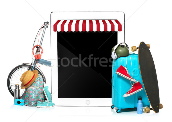 The blue suitcase, sneakers, clothing, hat, and laotop on white background. The travel, tourism  hol Stock photo © master1305