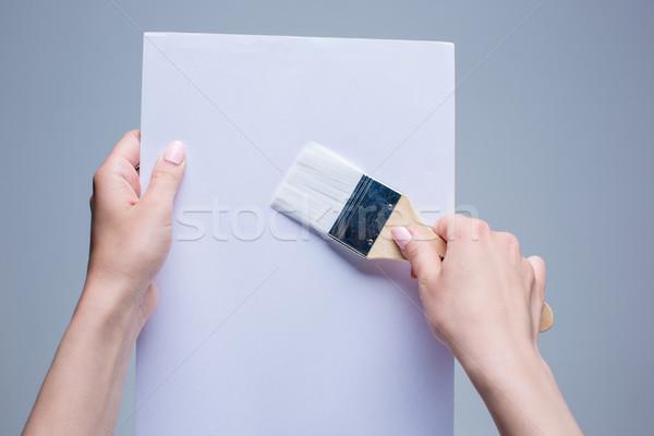 Mains peinture brosse blanche toile Photo stock © master1305