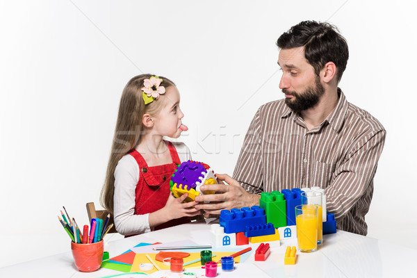 Father and daughter playing educational games together  Stock photo © master1305