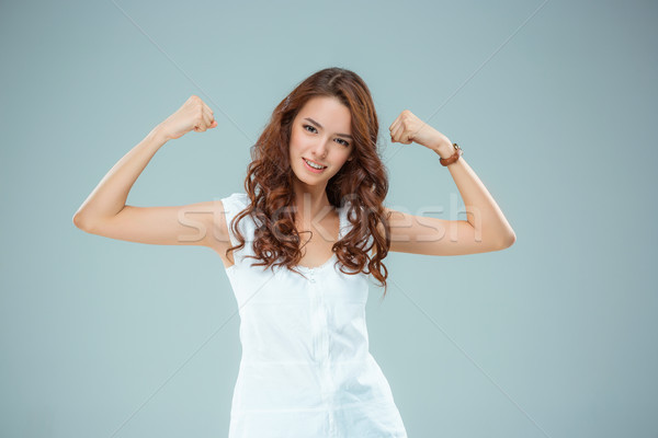 The happy woman on gray background Stock photo © master1305