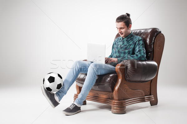 Portrait of young man with laptop and football ball Stock photo © master1305