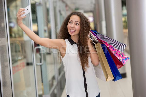 beautiful young woman goes shopping Stock photo © master1305
