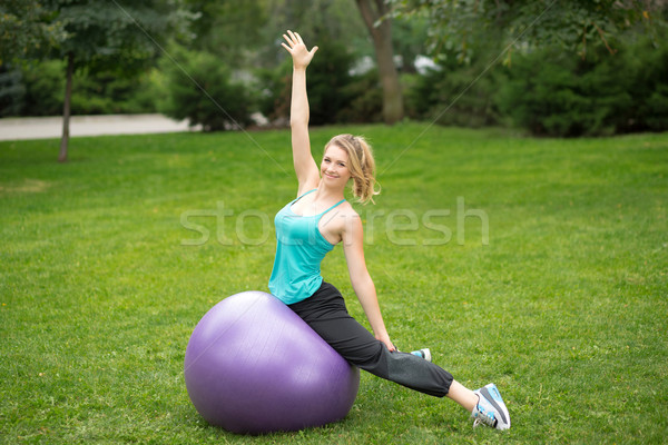 Young happy woman with fitness ball, outdoor Stock photo © master1305