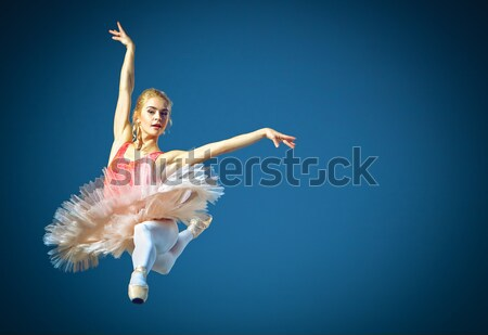 Beautiful female ballet dancer on a grey background.  Stock photo © master1305