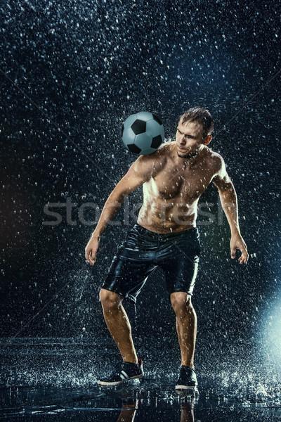 Water drops around football player Stock photo © master1305