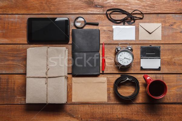Kellékek fa asztal telefon óra tollak nyakkendő Stock fotó © master1305
