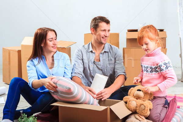 The happy family  during repair and relocation Stock photo © master1305