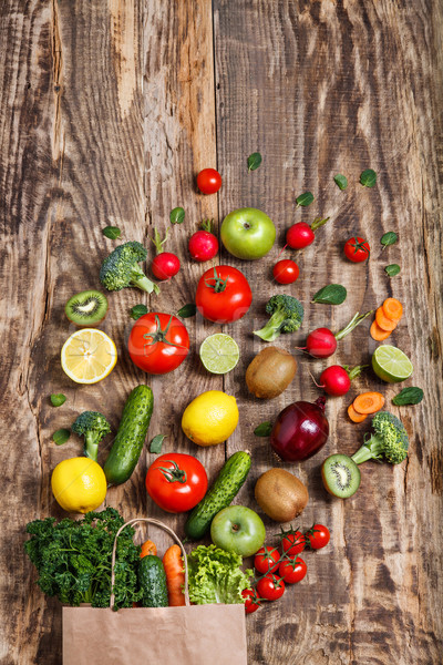 The vegetables from a paper bag on wooden table Stock photo © master1305