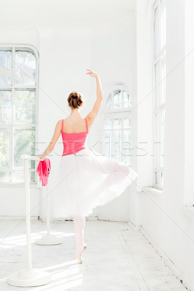 Ballerina posing in pointe shoes at white wooden pavilion Stock photo © master1305