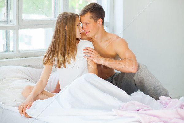 Lifestyle. Beautiful couple in bed Stock photo © master1305