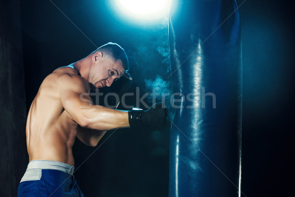 Férfi boxoló box homokzsák drámai ideges Stock fotó © master1305