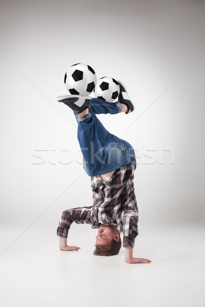 Portrait  of young man, practicing yoga with football balls Stock photo © master1305