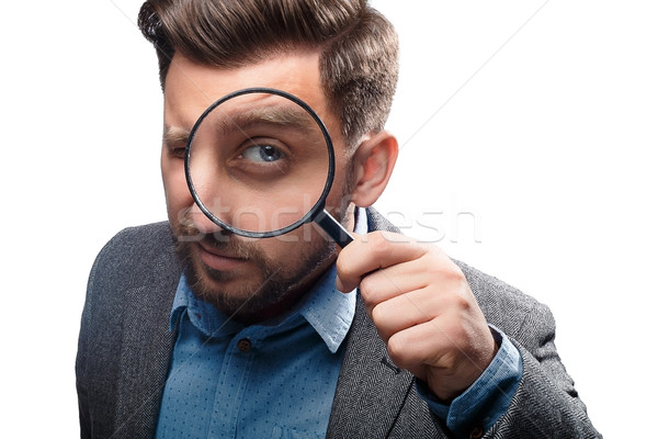 Man with magnifying glass on white background Stock photo © master1305