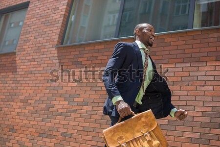 Stock photo: african black young businessman running in a city street