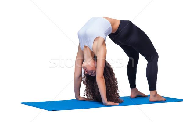 Jóvenes encajar mujer yoga aislado Foto stock © master1305