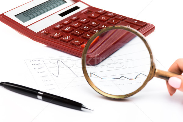 Stock photo: Magnifying glass with chart on paper