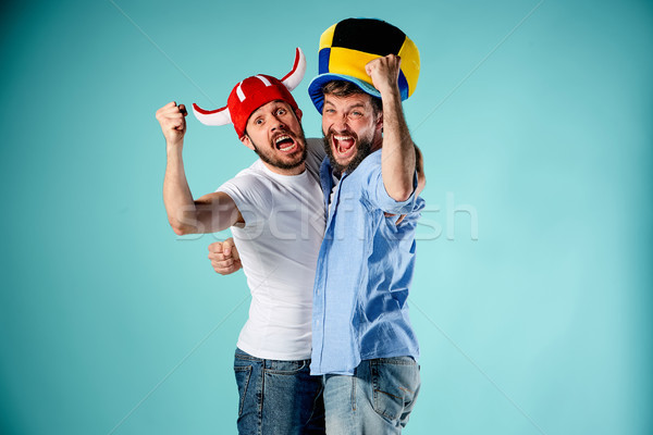 The two football fans over blue Stock photo © master1305