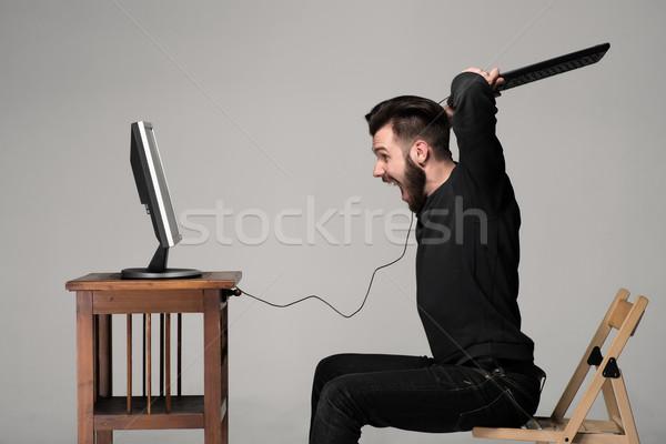 Colère homme clavier suivre ordinateur gris Photo stock © master1305