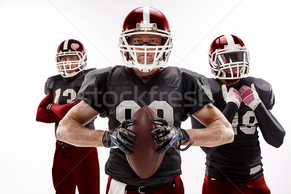 The three american football players posing with ball on white background Stock photo © master1305