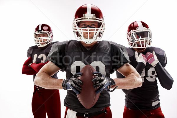 Drie amerikaanse voetbal spelers poseren bal Stockfoto © master1305