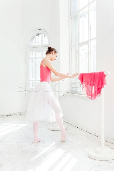 Stock photo: Ballerina posing in pointe shoes at white wooden pavilion