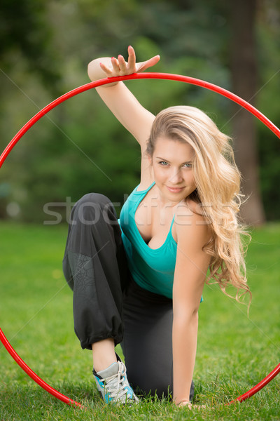 Young female athlete with hula hoop in the park Stock photo © master1305