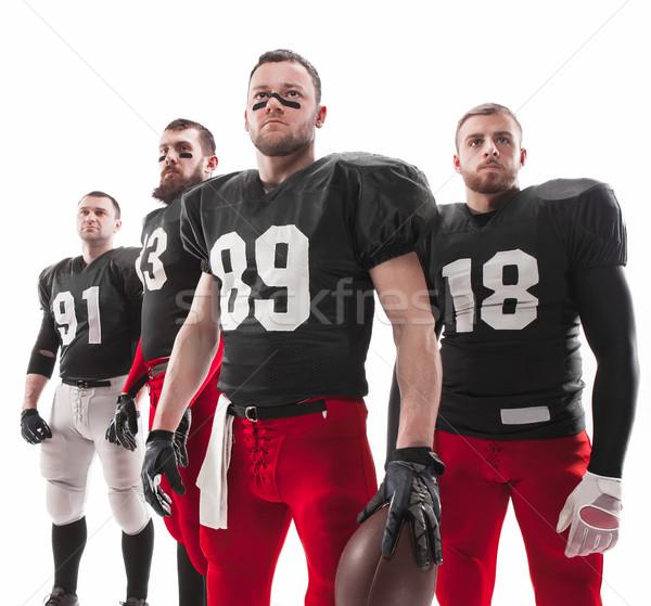 Négy amerikai futball játékosok pózol labda Stock fotó © master1305