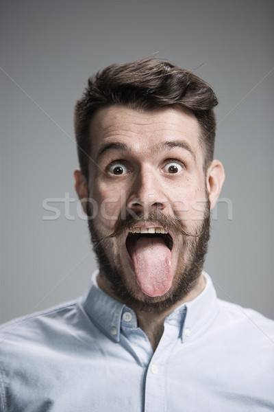 Stock photo: The tongue hanging out man
