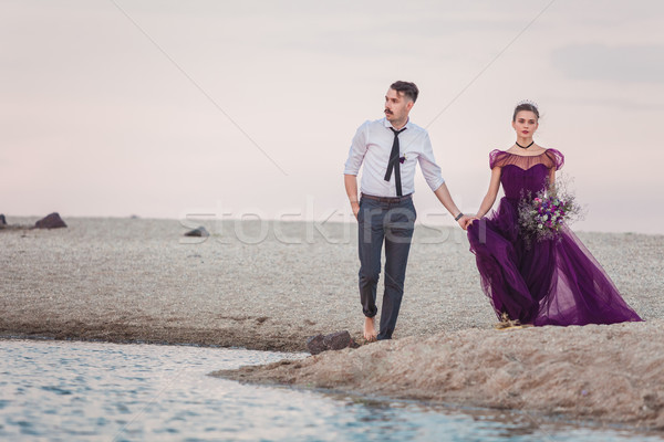 Young romantic couple running on the beach of sea Stock photo © master1305