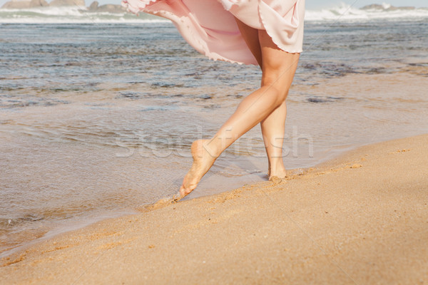 The young woman running on the beach Stock photo © master1305