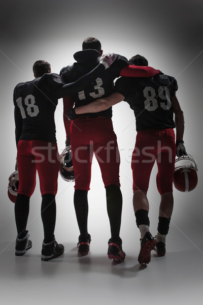The three american football players on gray background Stock photo © master1305