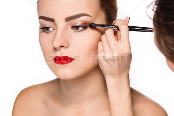Beautiful female eyes with make-up and brush Stock photo © master1305