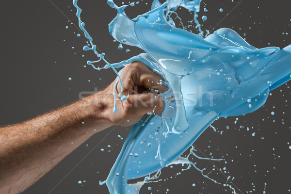 Close-up of a man's fist punching through liquid Stock photo © master1305