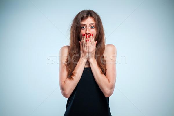 Portré fiatal nő megrémült arckifejezés szürke nők Stock fotó © master1305