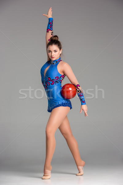 teenager doing gymnastics dance with red gymnastic ball Stock photo © master1305