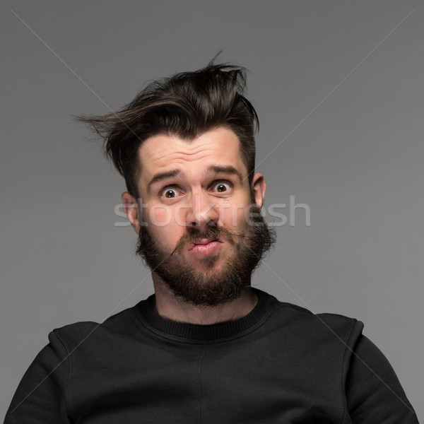 Portrait of young tousled man in studio Stock photo © master1305