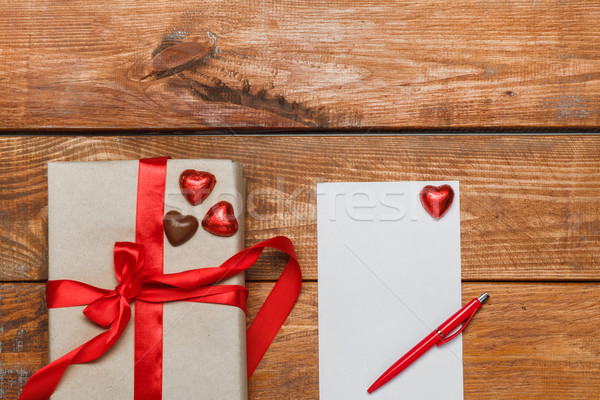 Stock photo: Vintage gift box with small hearts  on  wooden background