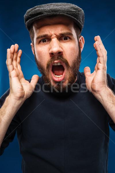 гнева кричали человека портрет молодым человеком Cap Сток-фото © master1305