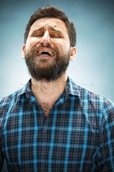 Płacz człowiek łzy twarz niebieski Zdjęcia stock © master1305