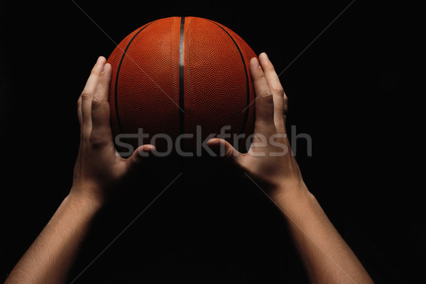 Basketball ball in male hands Stock photo © master1305