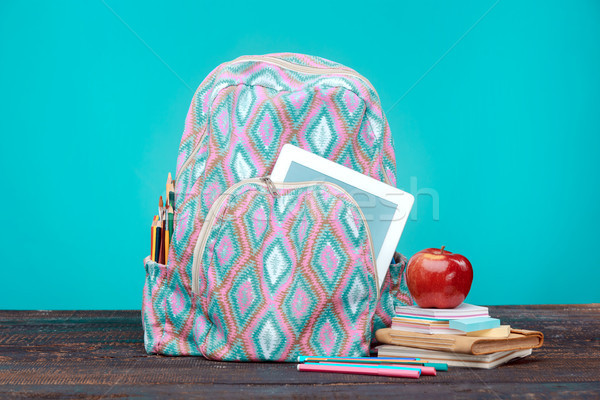 Back to School concept. Books, colored pencils and backpack Stock photo © master1305