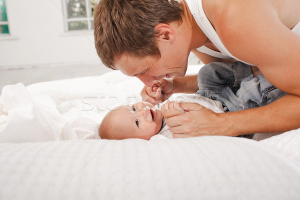young father with his nine months old son on the bed at home Stock photo © master1305