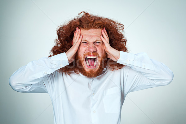 Stressed businessman with a headache Stock photo © master1305